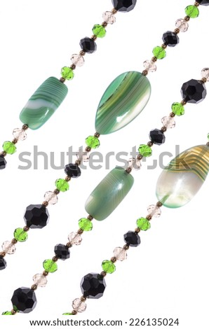 Green necklace on a white background - stock photo