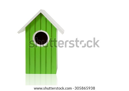 green nest box birdhouse house for birds isolated on white background with reflection - stock photo