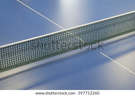 green net for pingpong and blue tennis table - stock photo