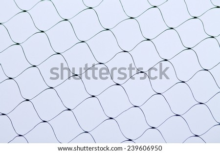 Green netting against the sky - stock photo