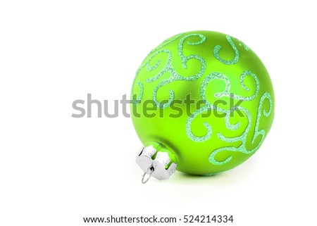 Green new year spruce tree decoration ball on white background.  Christmas celebration