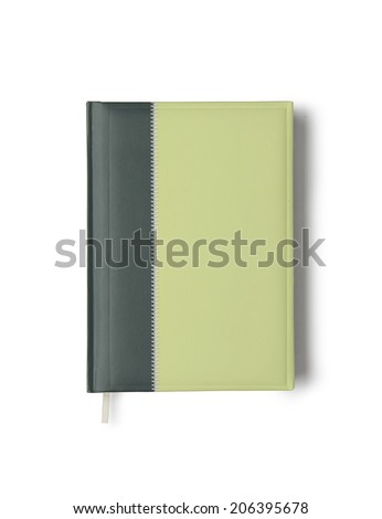 Green notebook isolated on white background with clipping path. Above view. - stock photo