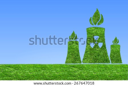 Green nuclear power plant icon on meadow.  The concept of ecology - stock photo