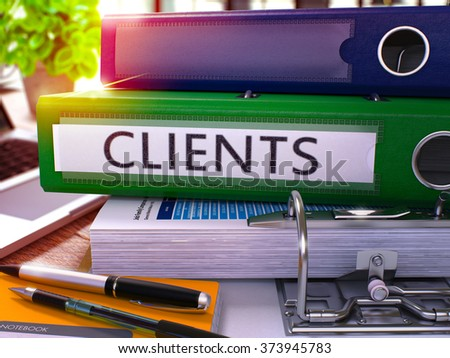 Green Office Folder with Inscription Clients on Office Desktop with Office Supplies and Modern Laptop. Clients Business Concept on Blurred Background. Clients - Toned Image. 3D