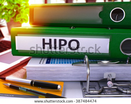 Green Office Folder with Inscription HiPo - High Potential - on Office Desktop with Office Supplies and Modern Laptop. HiPo Business Concept on Blurred Background. Hipo - Toned Image. 3D. - stock photo