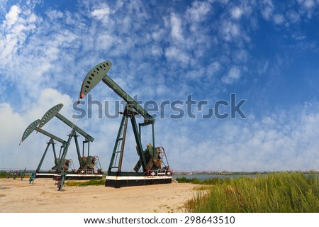 Green Oil pump oil rig energy industrial machine for petroleum crude - stock photo