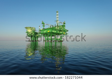 green oil rig platform on calm blue sea - stock photo