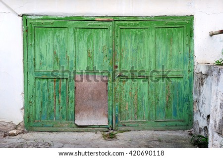 green old entry gate - stock photo