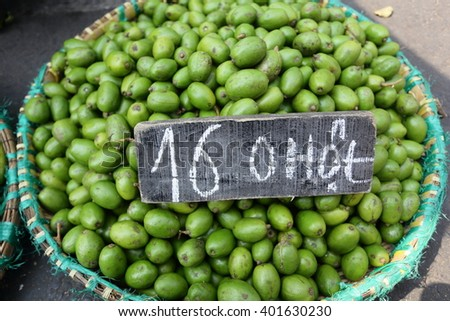 Green Olive on basket show price 16K or 16,000 VND on wood for 1 Kg.Vietnam language  - stock photo