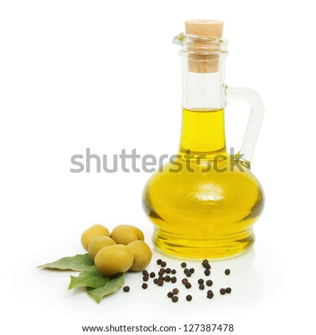 green olives and a bottle of olive oil - stock photo