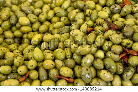 Green olives backgrounds at the street market