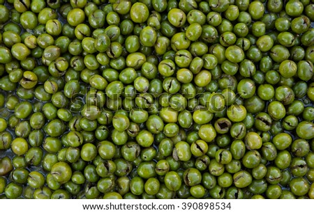 Green olives forming a background - stock photo