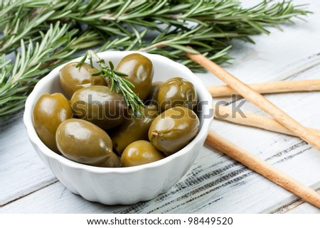 green olives in a bowl - stock photo