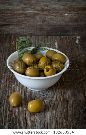 Green olives in a plate - stock photo