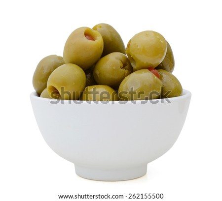 green olives in bowl on white background  - stock photo