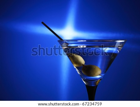 green olives in glass with martini. - stock photo