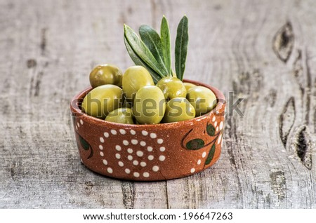 Green olives in great wooden background