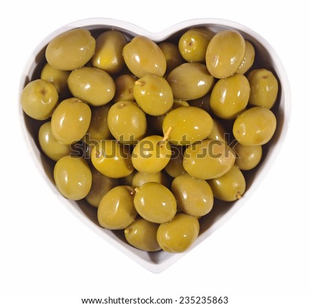 Green olives in plate in the form of heart on a white background