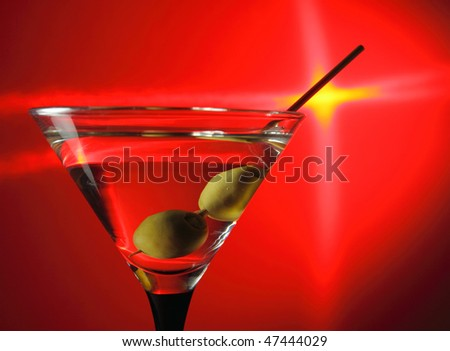 green olives in wineglass,focus on a olives