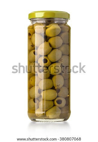Green olives on a white background in bottle with clipping path - stock photo