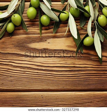 green olives over wooden background - stock photo
