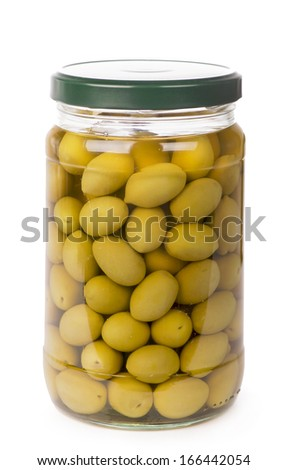 Green olives preserved in bank, bottle - stock photo