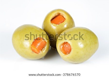 Green olives stuffed with red paprika isolated on white   - stock photo