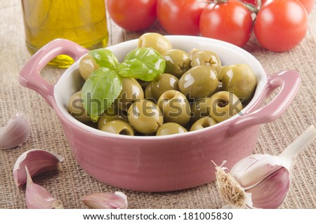 green olives with extra virgin olive oil in a bowl - stock photo