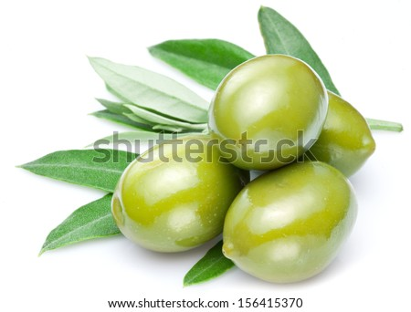 Green olives with leaves isolated on a white. - stock photo