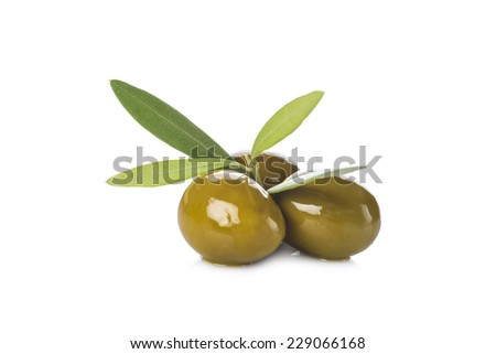 Green olives with leaves isolated on a white background - stock photo