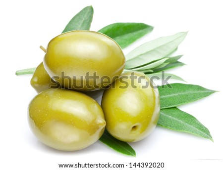 Green olives with leaves on a white background. - stock photo