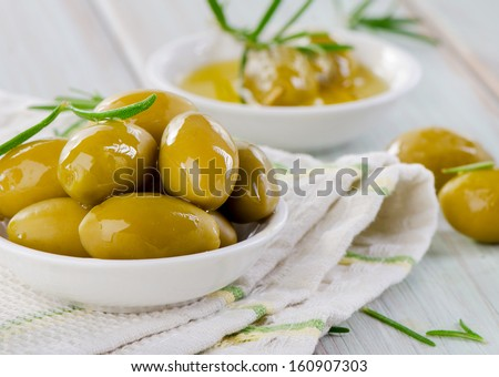 Green olives with olive oil. Selective focus