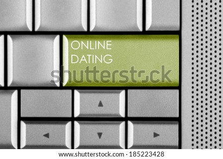 Green ON-LINE DATING key on a computer keyboard - stock photo
