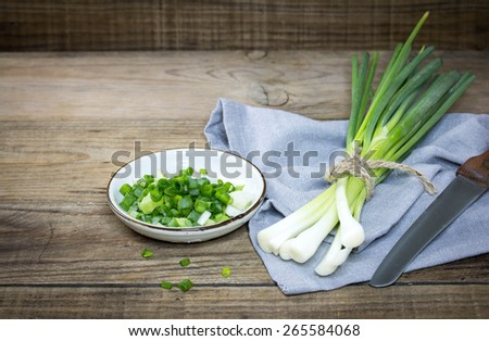 Green Onion on wood background - stock photo