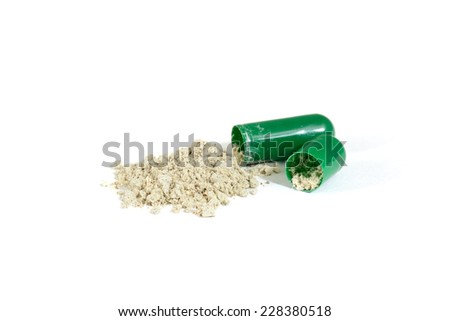 green opened capsule on white background - stock photo