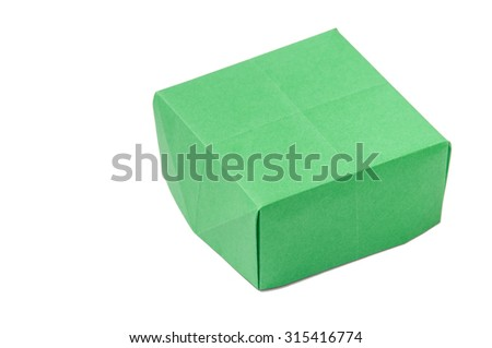 Green origami box over white background.