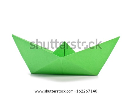 Green origami ship  side  - stock photo