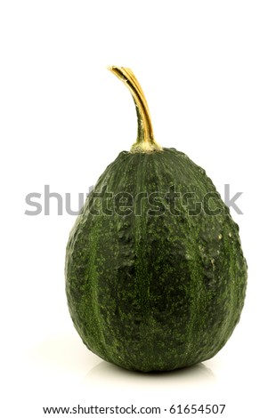 green ornamental pumpkin on a white background