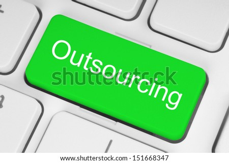 Green outsourcing button on white keyboard