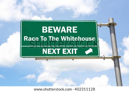 Green overhead road sign with a Beware of the Race To The Whitehouse Next Exit concept against a partly cloudy sky background. - stock photo