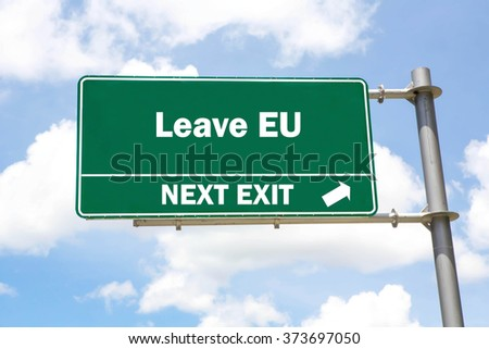 Green overhead road sign with a Leave EU Next Exit concept against a partly cloudy sky background. - stock photo