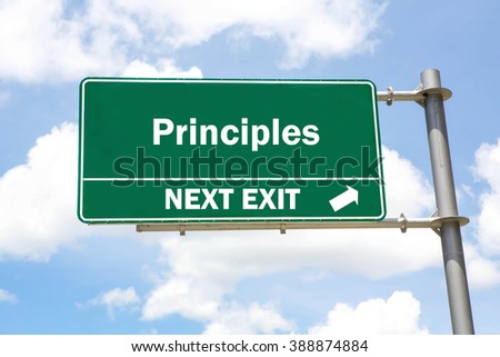 Green overhead road sign with a Principles Next Exit concept against a partly cloudy sky background. - stock photo
