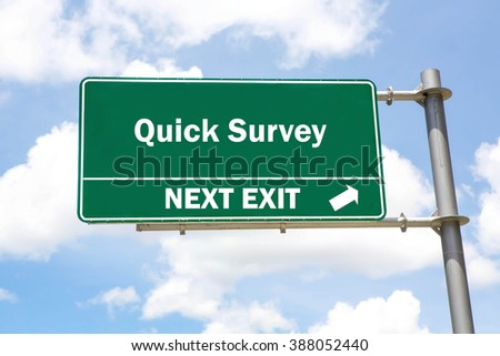 Green overhead road sign with a Quick Survey Next Exit concept against a partly cloudy sky background. - stock photo
