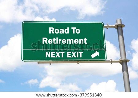 Green overhead road sign with a Road to Retirement Next Exit concept against a partly cloudy sky background. - stock photo