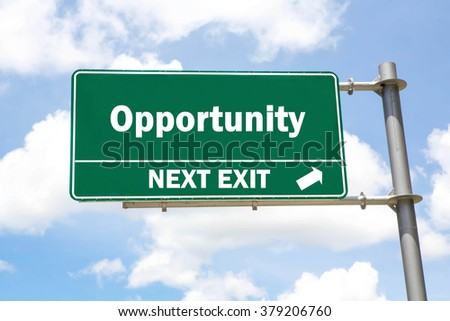 Green overhead road sign with an Opportunity Next Exit concept against a partly cloudy sky background. - stock photo