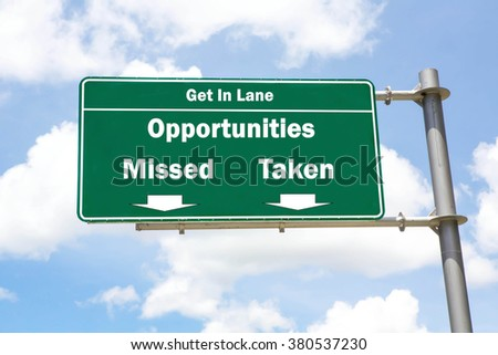 Green overhead road sign with the instruction to get in lane with an Opportunities Missed Or Opportunities Taken concept against a partly cloudy sky background. - stock photo