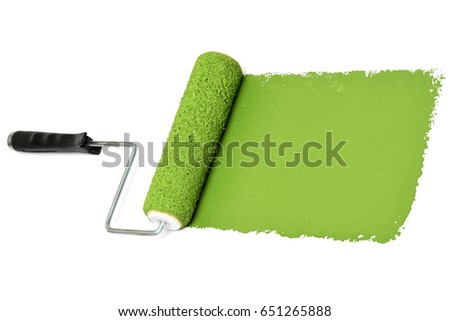 Green paint roller over white wall
