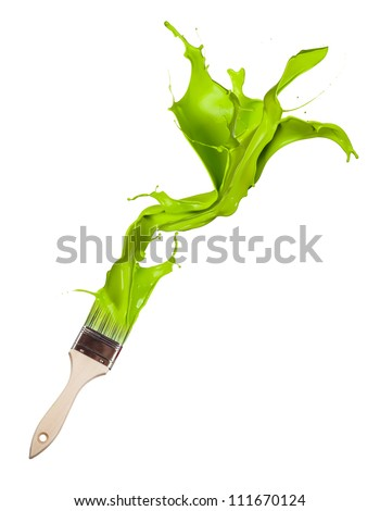 Green paint splashing out of brush. Isolated on white background - stock photo