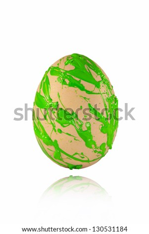 Green paint spray on the easter egg