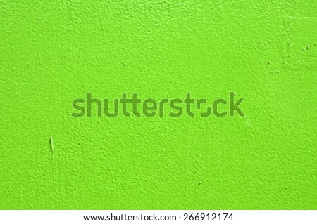 Green painted metal surface closeup as background - stock photo